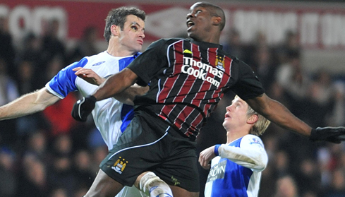 Micah battles with Ryan Nelsen for the ball
