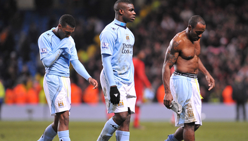 Micah, Daniel Sturridge and Darius Vassel leave the pitch dejected after the match