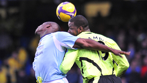 Micah and Titus Bramble battle for the ball in the air