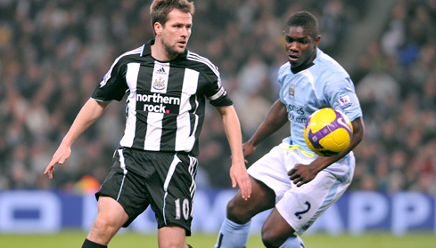 Micah battles with Newcastle's Michael Owen