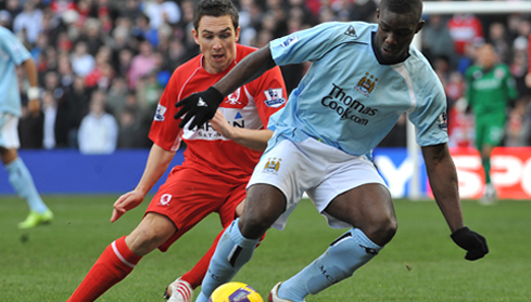 Micah and Stewart Downing battle for the ball