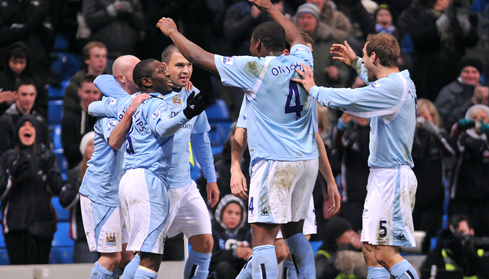 Shaun Wright-Phillips celebrates with his team mates