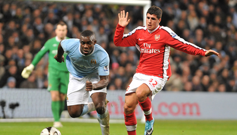 Micah and Arsenal's Fran Merida battle for the ball