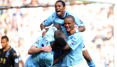 Richard Dunne celebrates scoring City's second goal of the game with Micah and co.