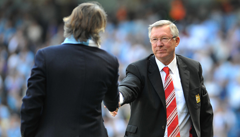 Roberto Mancini shakes hands with Alex Ferguson after the final whistle