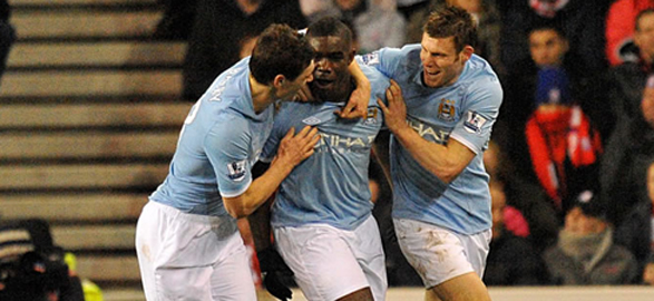 Micah celebrates with team mates