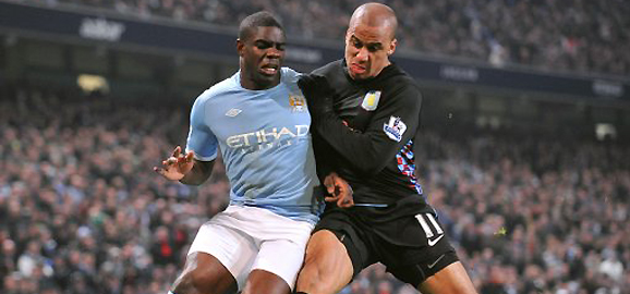 Micah Richards and Aston Villa's Gabriel  Agbonlahor battle for the ball