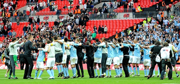 City players celebrating with the Poznan dance