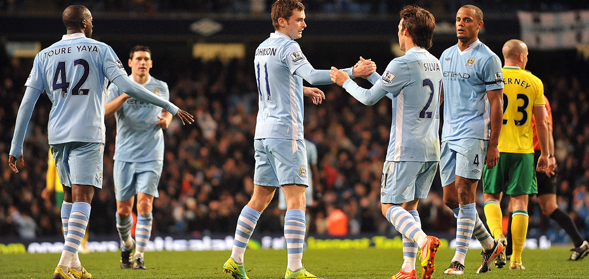 City players celebrate after scoring