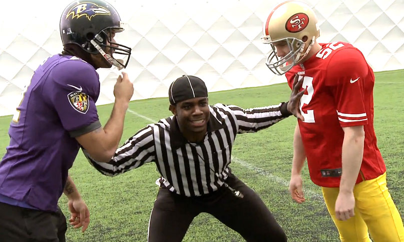 Micah referees Lescott (Ravens) v Milner (San Francisco 49ers) in a Quarterback Crossbar Challenge ahead of the Super Bowl 47