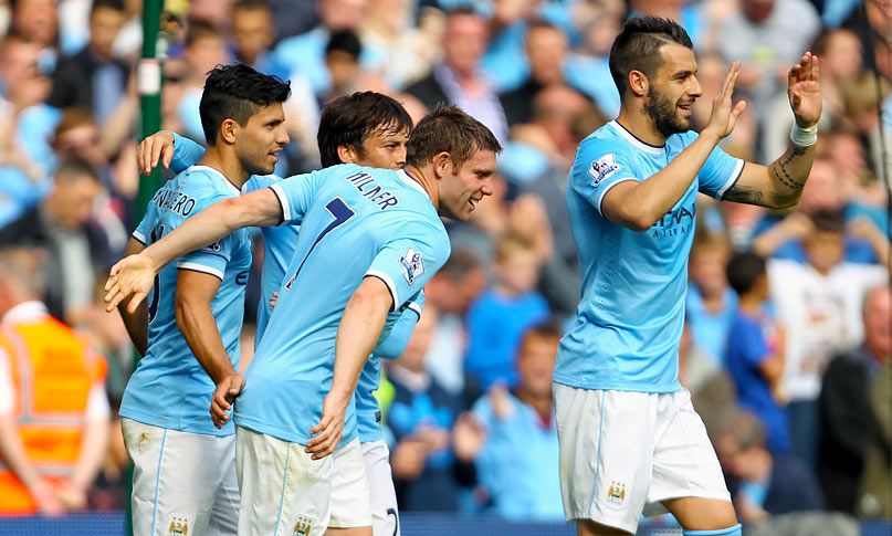 Manchester City's Sergio Aguero celebrates with teammates after his penalty