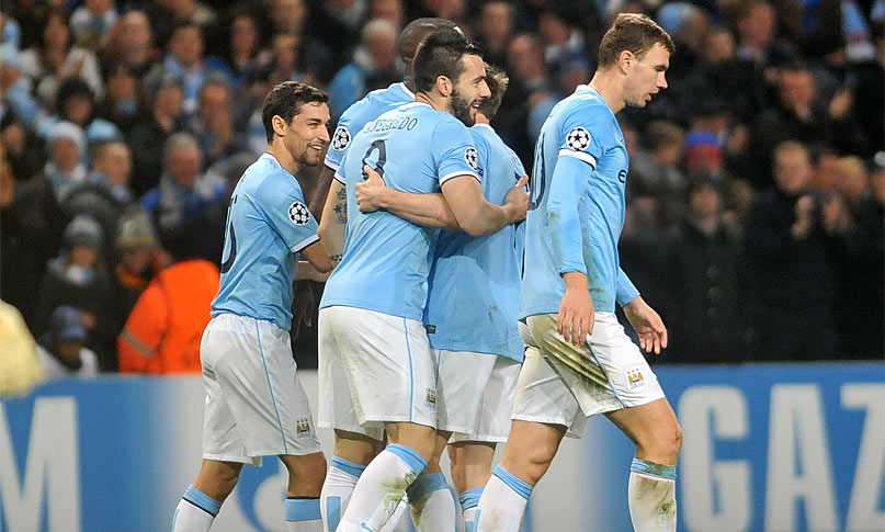 Alvaro Negredo celebrates with team-mates after scoring his team's third goal