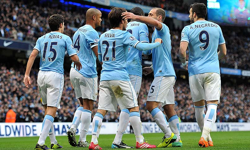 David Silva celebrates scoring his side's fourth goal.