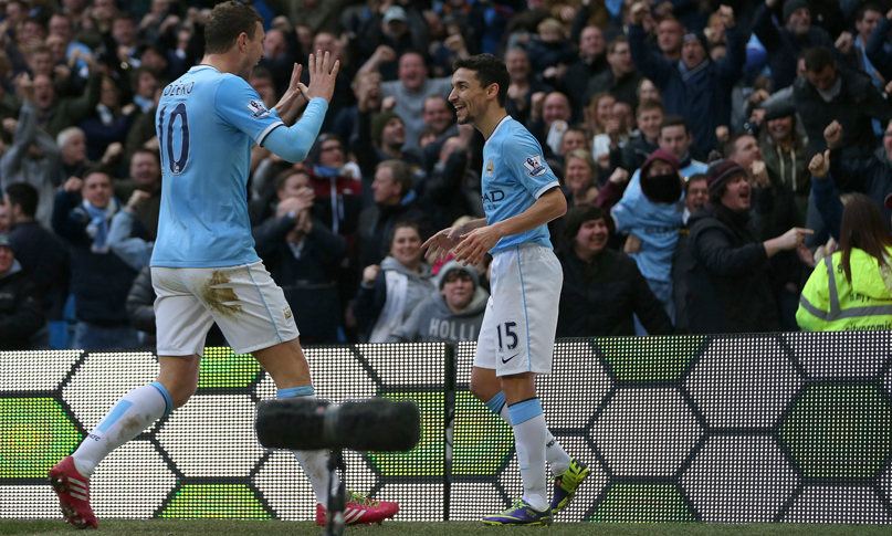 Dzeko and Navas celebrate goal