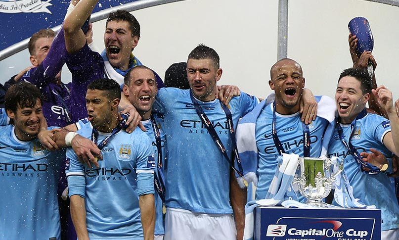 Manchester City celebrate their 3-1 win in the Capital One Cup final at Wembley.