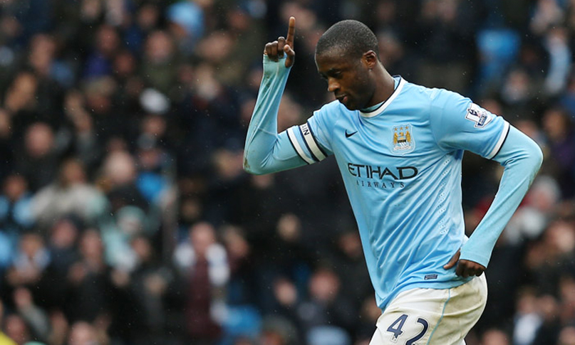 Toure celebrates his hat-trick
