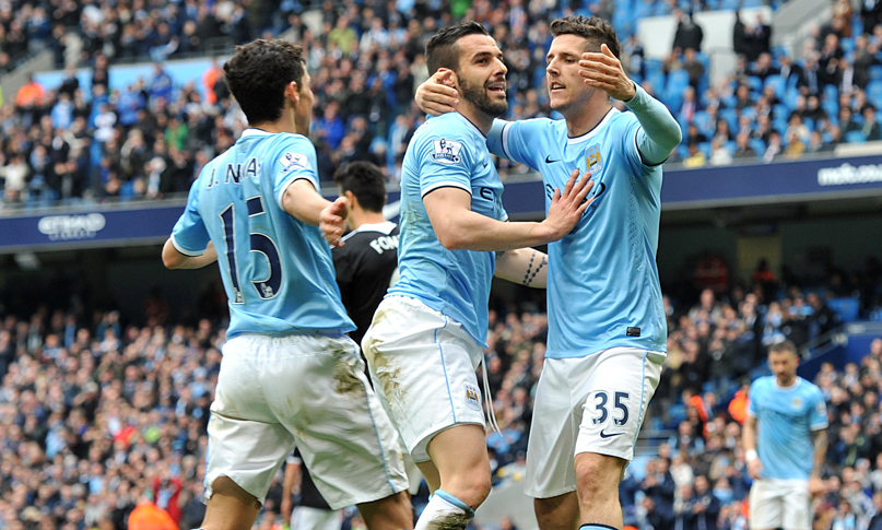 Stevan Jovetic celebrates with team-mates after scoring his team's fourth goal