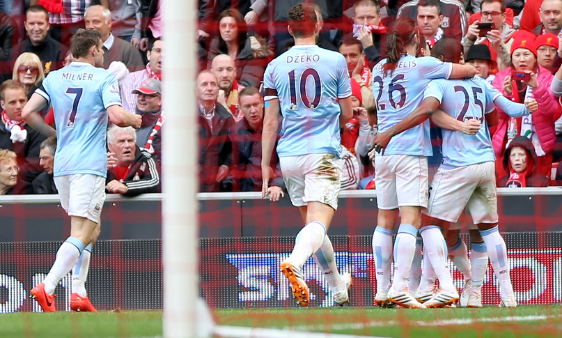 City players celebrate their second goal against Liverpool, and own goal from Glen Johnson