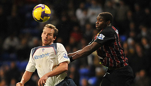 Kevin Davies and Micah battle for the ball