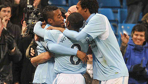 Robinho is congratulated by his team mates after scoring the second goal