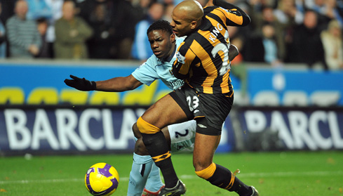 Micah and Hull City's Marlon King battle for the ball