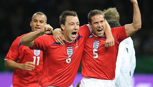 Matthew Upson celebrates scoring with John Terry during the International Friendly at the Olympic Stadium in Berlin, Germany