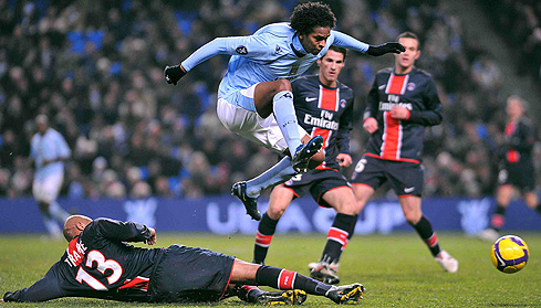 Joao Alves Jo jumps over a tackle from Paris Saint Germain's Sammy Traore