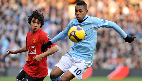 Manchester Derby - Robinho and Rafeal Da Silva battle for the ball