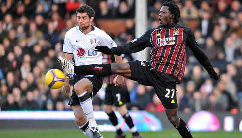 Aaron Hughes and Benjani Mwaruwari battle for the ball